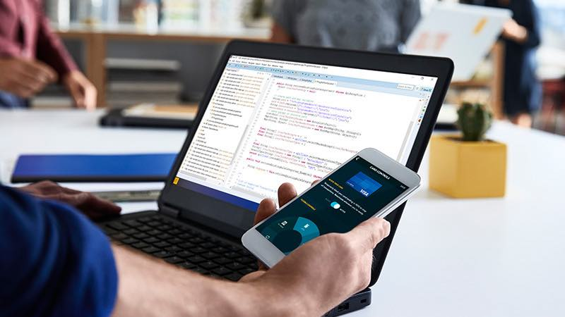 coding on laptop and phone